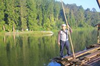 Standing on bamboo raft